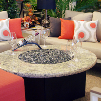 Fire table by couches with pillows