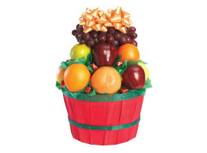 red basket with an array of fruit from stauffers fresh foods